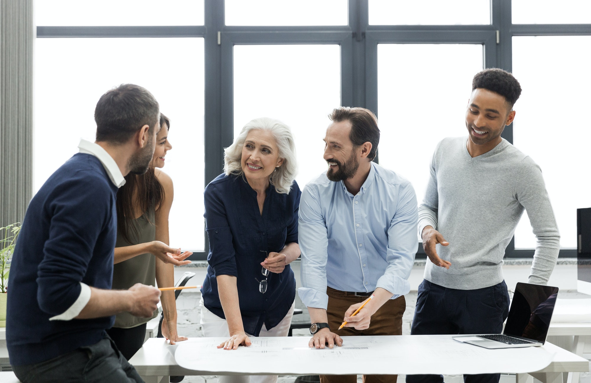 Group of smiling business people busy discussing