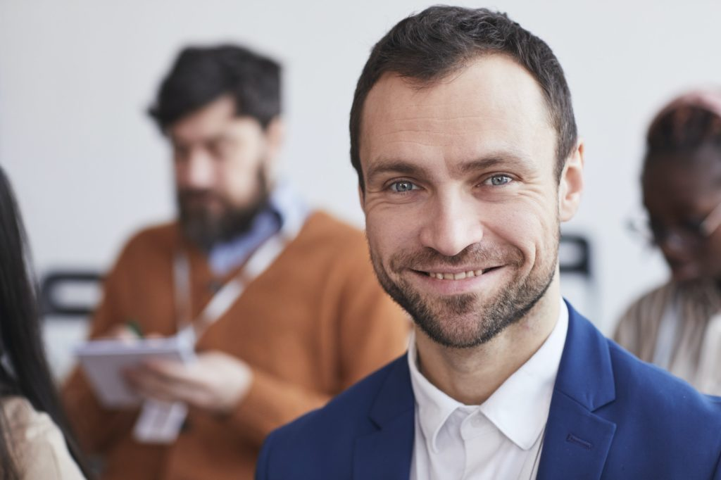 Smiling Man at Business Conference